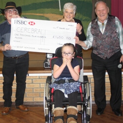 Winnie Forsdike being presented with a cheque