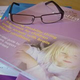Booklet with reading glasses