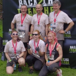 Successful mud runners receive their medals