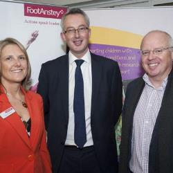 CEO Chris Jones with staff from foot anstey