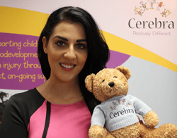 Samira with a Cerebra teddy bear