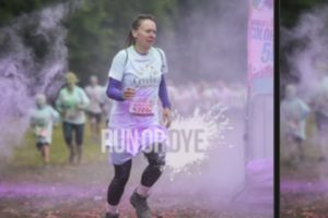 Karen taking part in one of the 5k Run or dye challenges