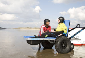 Kai using the Surf Access Vehicle