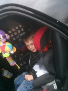 Cole in the car with his safety gate