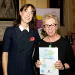 Christine receiving her award from Samantha Cameron