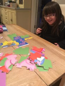 Chloe completing a Peppa Pig jigsaw