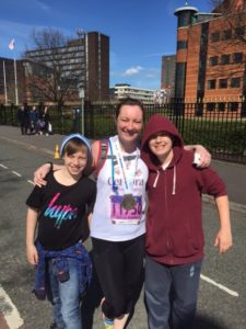 Sarah with her two sons at the finish line