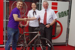 Ron handing over the bike to Rob