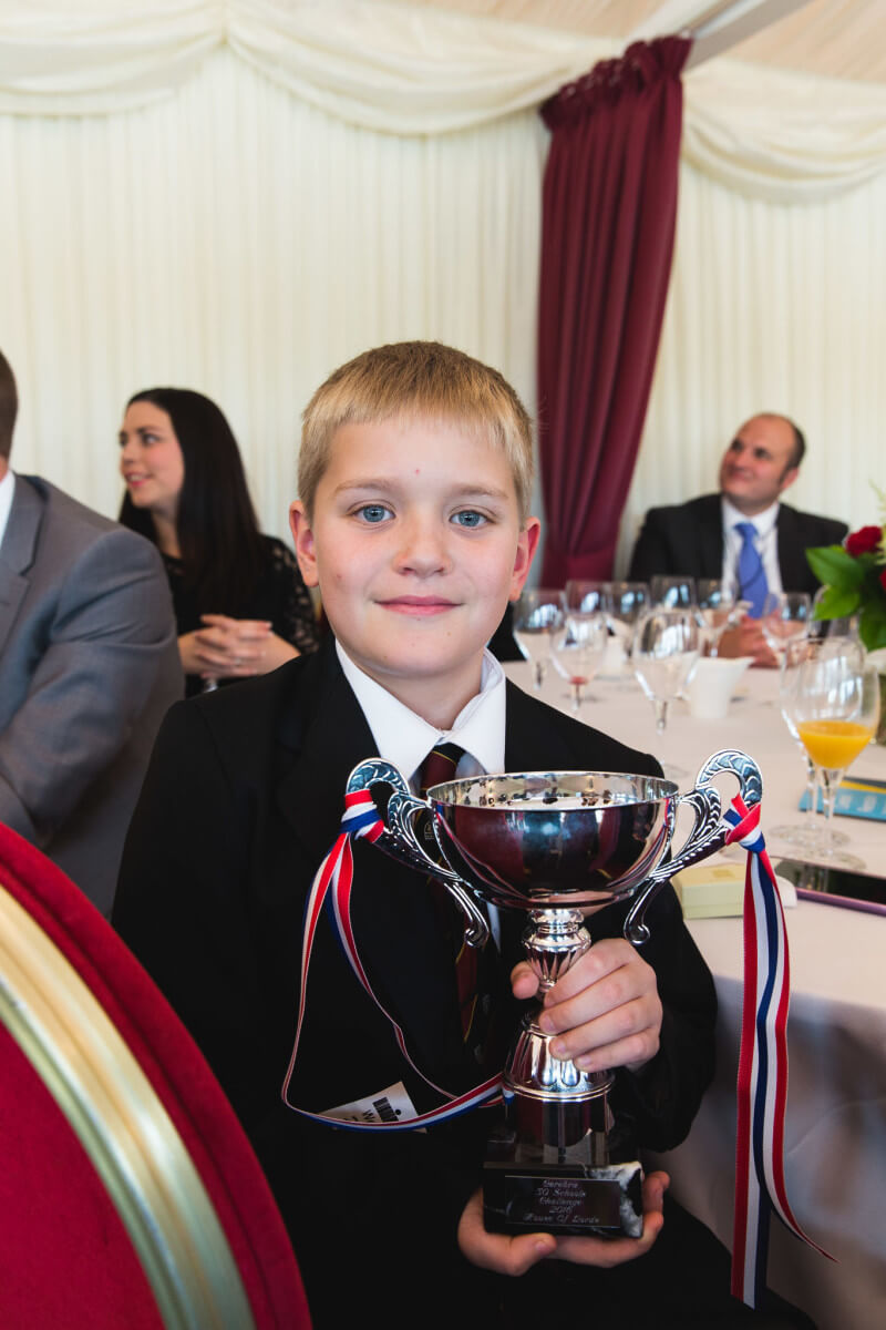 Isaac with the 50 Schools Challenge trophy