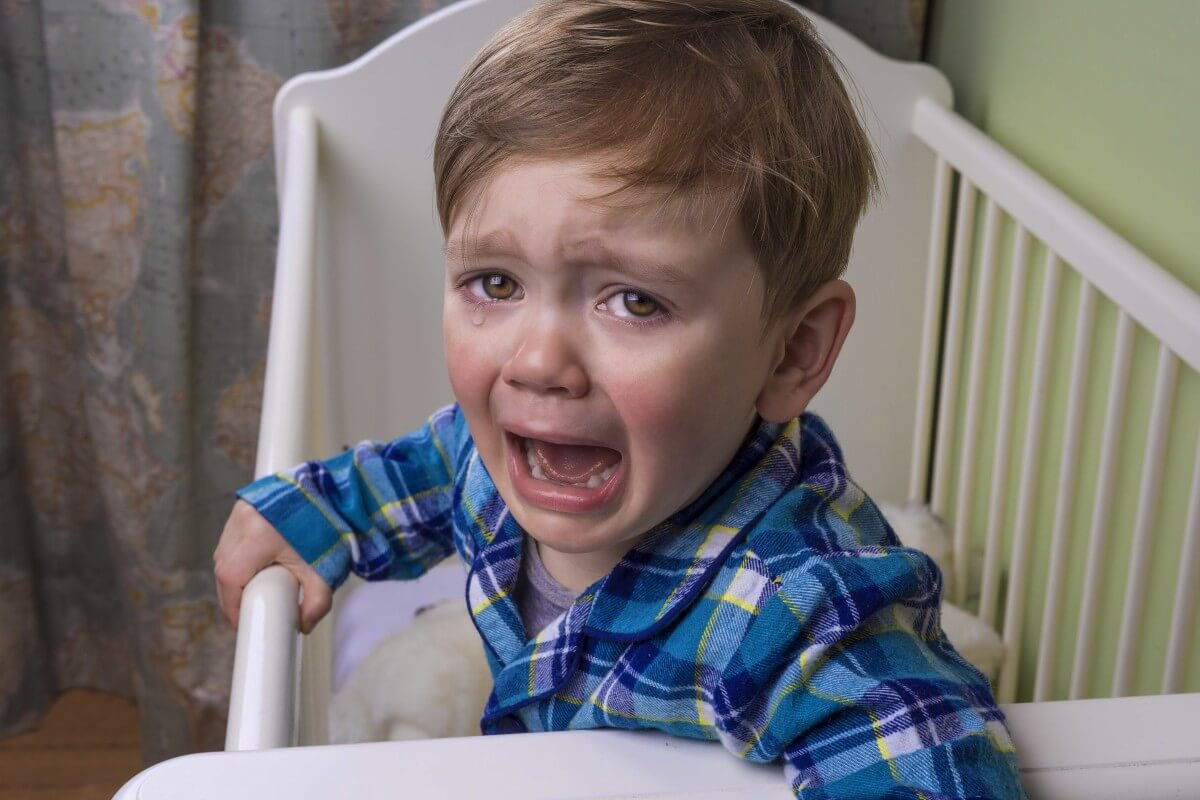 Child crying in a cot