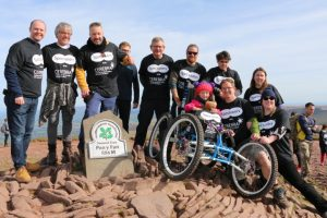 Specsavers directors, team members and Cerebra staff with Imogen at the Pen y Fan summit