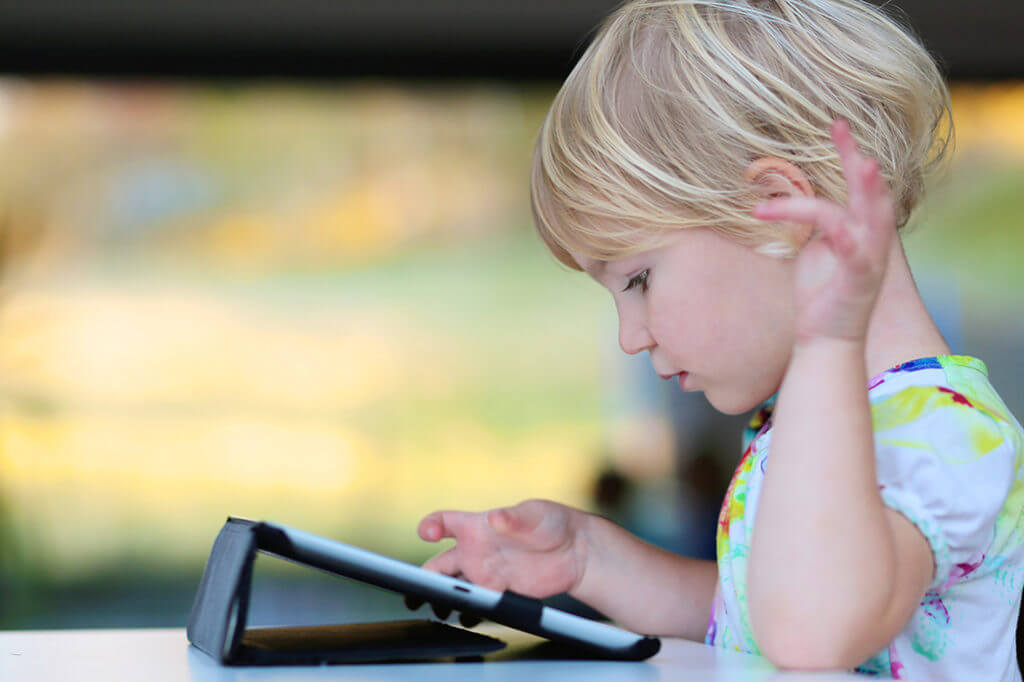 Child reading an ebook.