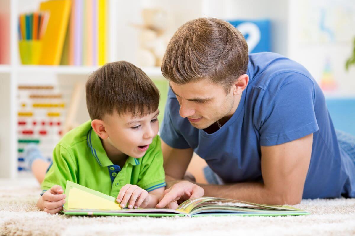 little boy and father reading together