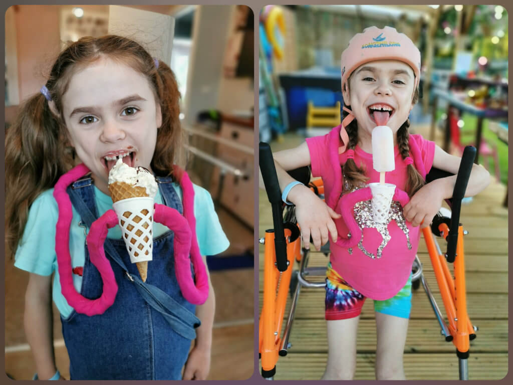 Carmela enjoying an ice-cream and lolly using the holder made by the Cerebra Innovation Centre