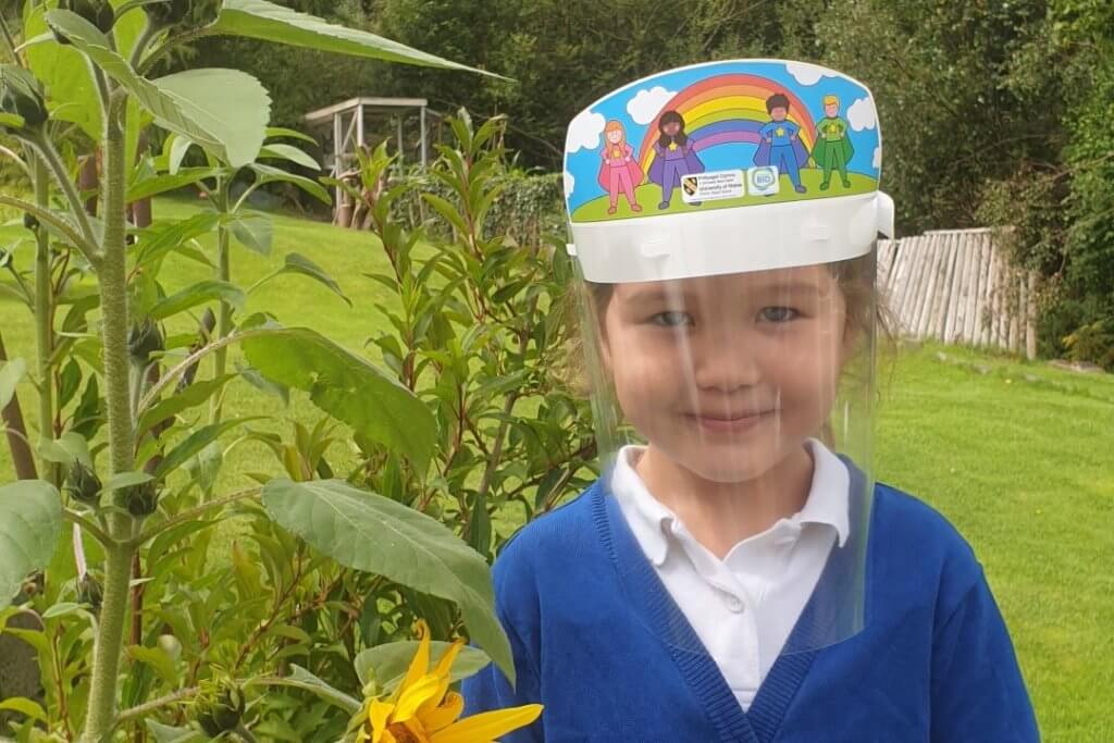 little girl wearing a bright coloured visor