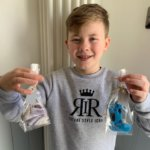 Charlie holding his bags of home made cookies