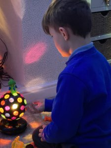 Image of Harrison playing with a sensory toy