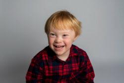 smiling little boy who got a good night's sleep thanks to the cerebra sleep service