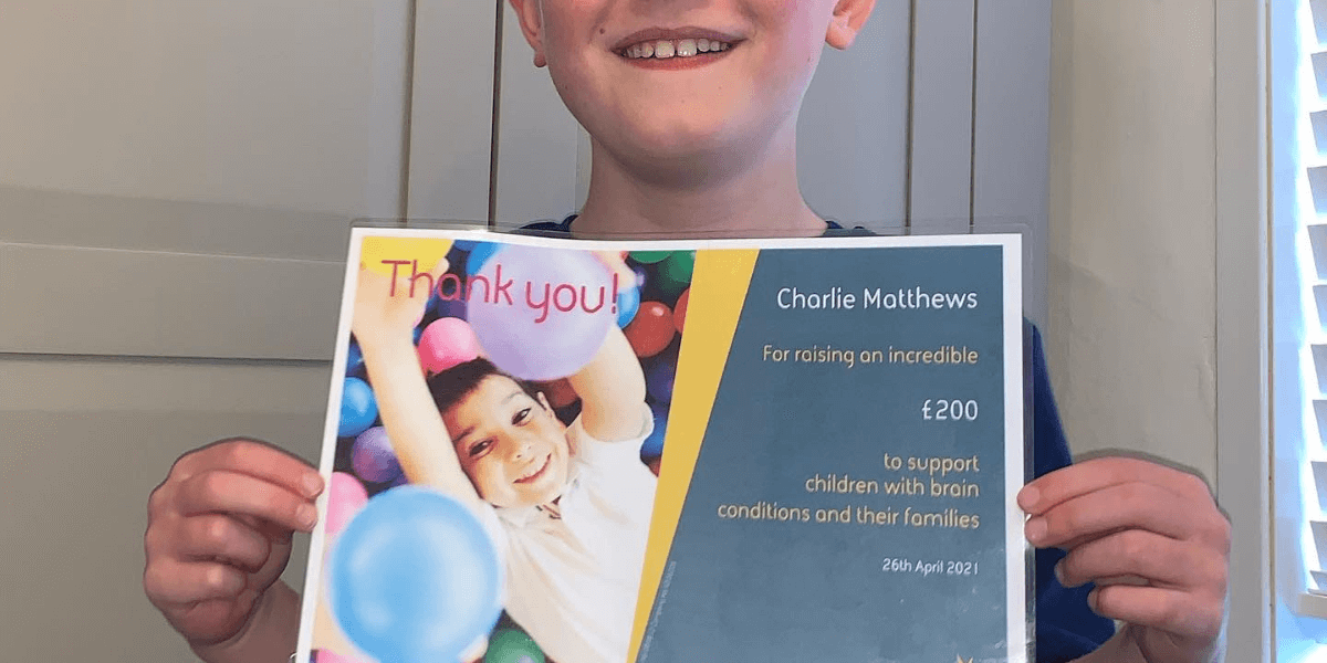 Charlie with his certificate from Cerebra