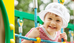 Girl on a climbing frame, physical well-being help from Cerebra charity.