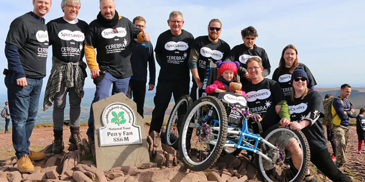 Specsavers and Imogen at the top of Pen y Fan
