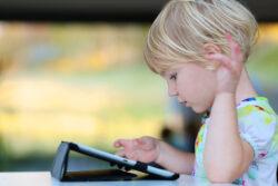Child reading an ebook.