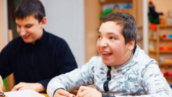 smiling teenage boy with a disability